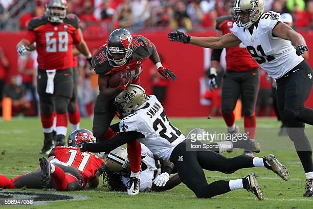 Tampa Bay Buccaneers running back Charles Sims is tackled by New Orleans Saints cornerback Damian Swann in the 4th quarter of the NFL game between...