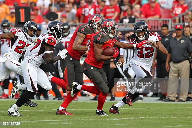 Tampa Bay Buccaneers running back Charles Sims tries to avoid being tackled by Atlanta Falcons cornerback Jalen Collins and Atlanta Falcons free...