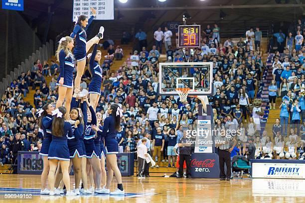 The Villanova cheerleaders build a pyramid during a break in the NCAA basketball game between the La Salle Explorers and the Villanova Wildcats...
