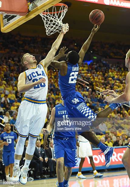 UCLA Bryce Alford attempts to block a shot by Kentucky Dominique Hawkins during an NCAA basketball game between the Kentucky Wildcats and the UCLA...