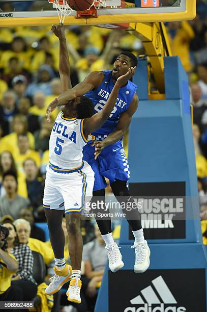 UCLA Prince Ali puts up a big dunk over Kentucky Alex Poythress who also fouled him on the play during an NCAA basketball game between the Kentucky...