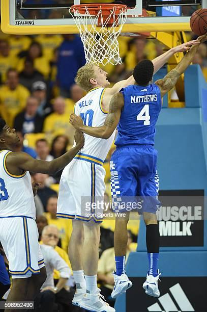 UCLA Thomas Welsh blocks a shot by Kentucky Charles Matthews during an NCAA basketball game between the Kentucky Wildcats and the UCLA Bruins at...