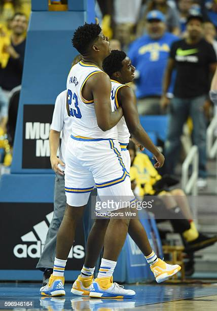 UCLA Tony Parker picks up UCLA Prince Ali after throwing down a big dunk during an NCAA basketball game between the Kentucky Wildcats and the UCLA...