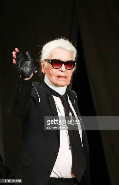 December 2017, Hamburg: Fashion designer Karl Lagerfeld waves to the end of the exclusive fashion show in the Great Hall of the Elbphilharmonie. The...