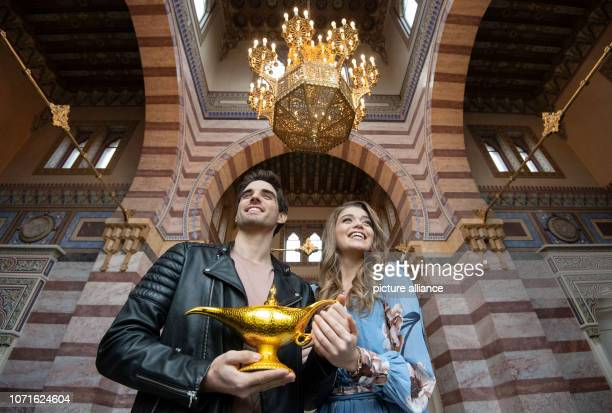 10 December 2018 BadenWuerttemberg Stuttgart Philipp Büttner and Nienke Latten the main actors of the musical 'Aladdin' hold a prop in their hands in...