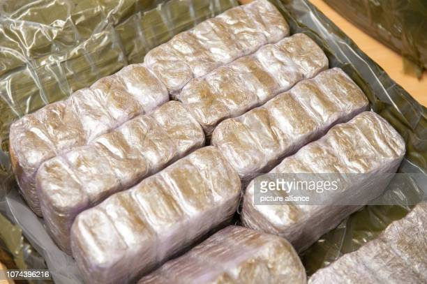 Around 90 kilograms of hashish are lying on a table at the Ansbach criminal police inspection during a press conference According to a police press...