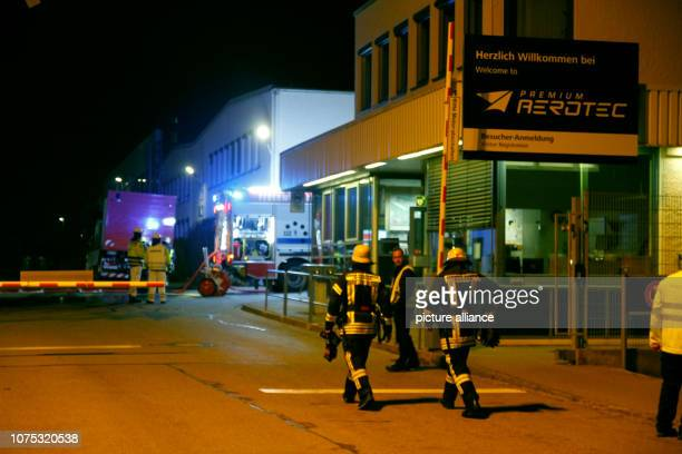 Firefighters are standing with their fire engines in front of the factory of the aviation supplier Premium Aerotec There was a fire in Augsburg...
