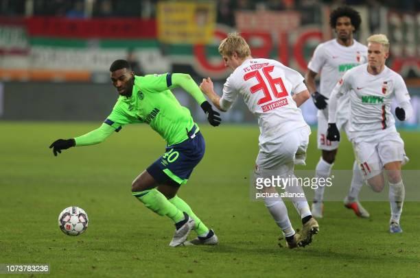 Soccer Bundesliga FC Augsburg FC Schalke 04 15th matchday in the WWKArena Haji Amir Wright fights with Augsburg's Martin Hinteregger for the ball...