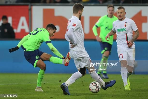 Soccer Bundesliga FC Augsburg FC Schalke 04 15th matchday in the WWKArena Schalke's Amine Harit shoots the ball through the legs of Augsburg's...