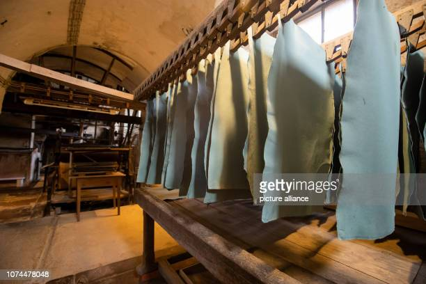 December 2018, Bavaria, Homburg: Blue cardboard , hanging in the machine cellar of the historic paper mill. The manufactory in the Triefenstein...