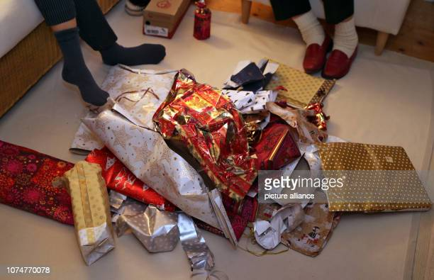 Packaging paper of Christmas presents lies in a living room on a heap Photo KarlJosef Hildenbrand/dpa