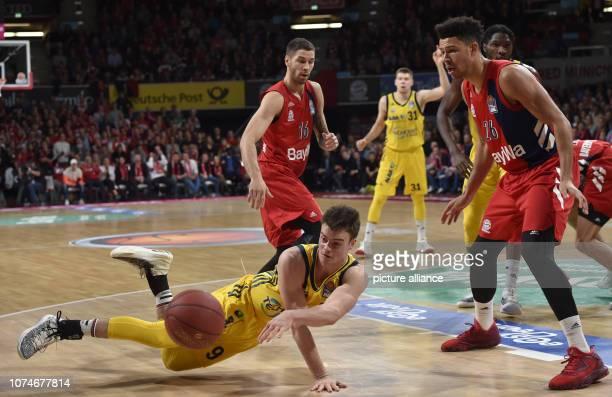 Basketball BBL Cup quarter finals FC Bayern Munich ALBA Berlin Audi Dome Stefan Jovic and Marvin Ogunsipe from Munich fight with Jonas Mattisseck...