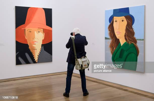During a press preview at the Brandhorst Museum a man photographs the pictures 'Red Hat' and Maureen in the retrospective 'Alex Katz' The exhibition...