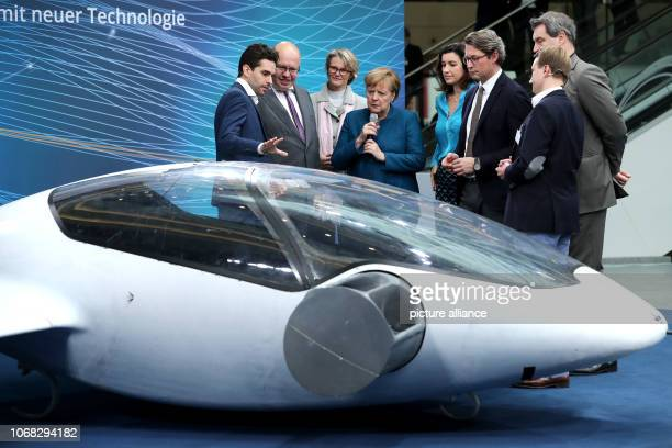 Daniel Wiegand inventor of eVTOL electric vertical takeoff and landing Jet and his colleague present to Peter Altmaier Federal Minister of Economics...