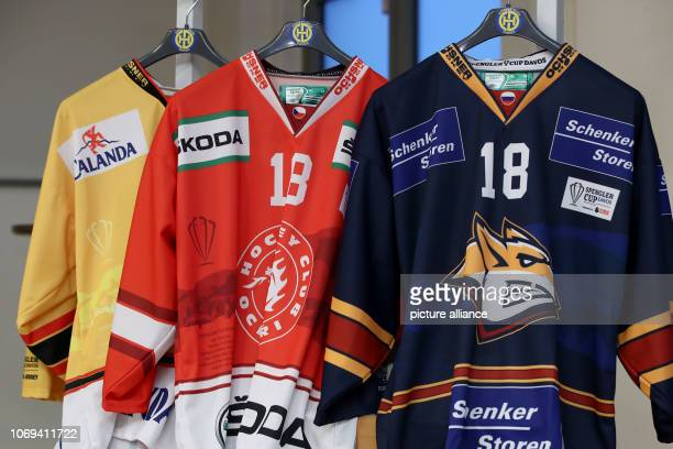 December 2018, Bavaria, Nürnberg: Jerseys of the teams participating in the Spengler Cup 2018 will be displayed during the press conference of the...
