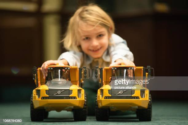 Levi plays with two 'Volvo A60H Dumpers' from 'BRUDER Spielwaren GmbH Co KG' The toy industry reported on expectations and trends at a press...