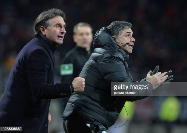 Soccer Bundesliga 1st FC Nuremberg VfL Wolfsburg 15th matchday in Max Morlock Stadium The Wolfsburg coach Bruno Labbadia cheers with assistant coach...