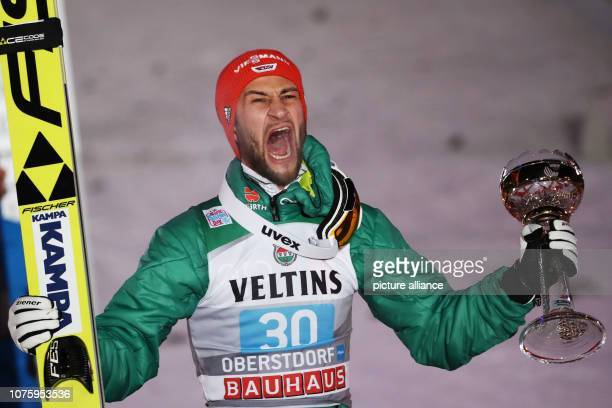 Ski jumping Four Hills Tournament Big Hills Gentlemen 2nd Passage Markus Eisenbichler ski jumper from Germany cheers at the award ceremony for second...