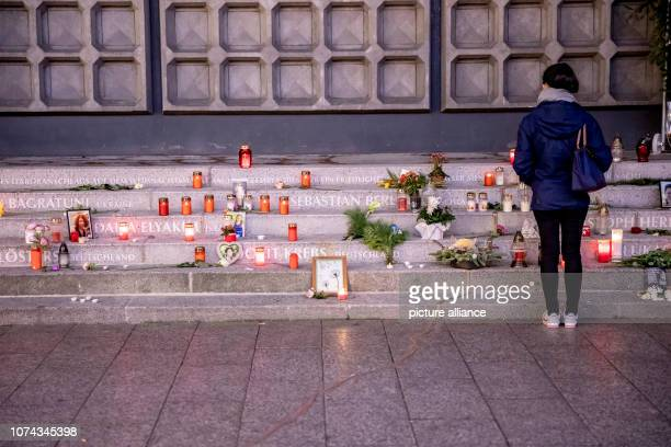 A woman stands at the Christmas market at Breitscheidplatz in front of the memorial for the victims of the assassination on Two years after the...