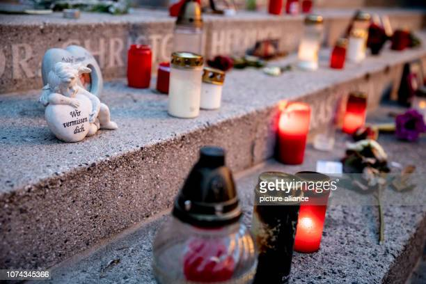 An angel figure and lights can be seen at the memorial for the victims of the assassination of at the Christmas market at Breitscheidplatz Two years...