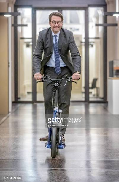 Andreas Scheuer Federal Minister of Transport and Digital Infrastructure is driving an electric scooter through the corridors of the Ministry of...