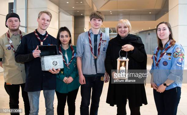 In the German Bundestag a delegation of German Girl Scouts hands over the peace light from Bethlehem to Claudia Roth Deputy President of the...
