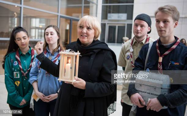 In the German Bundestag a delegation of German scouts hands over the peace light from Bethlehem to Claudia Roth deputy president of the Bundestag...