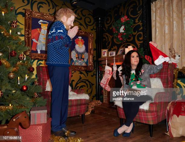 The live characters of Prince Harry and his pregnant wife Meghan play a possible scenery in a Christmassy decorated living room in Madame Tussauds...