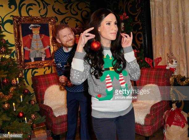 The live characters of Prince Harry and his wife Meghan play a possible scenery in a Christmassy decorated living room in Madame Tussauds The wax...
