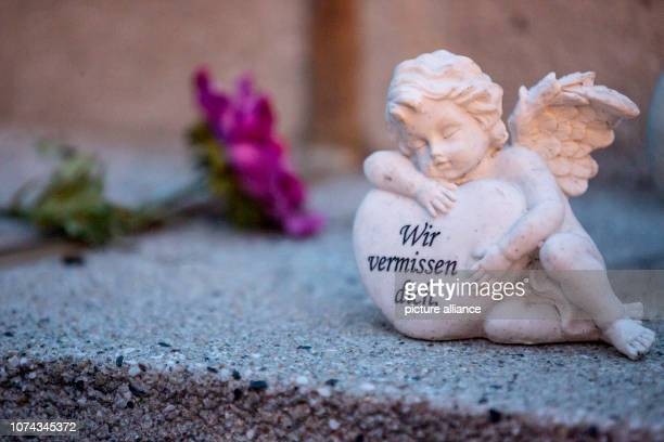 'We miss you' stands at the memorial for the victims of the assassination of at the Christmas market at Breitscheidplatz on an angel figure Two years...