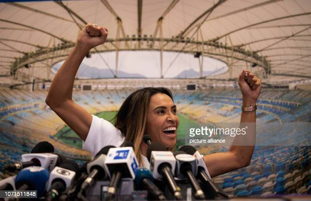 Marta who has been honoured six times as a world footballer by the FIFA World Football Association smiles at a press event in the Maracana Stadium...