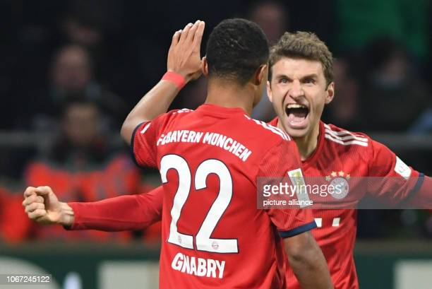 Soccer Bundesliga Werder Bremen Bayern Munich 13th matchday in the Weserstadion Bavaria's Thomas Müller cheers with Serge Gnabry after his goal to 12...
