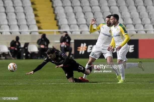 Football Europa League Group Phase Group A 6th Matchday Larnaca Bayer Leverkusen at the GSP Stadium Apostolos Giannou of Larnaka and Lucas Alario of...