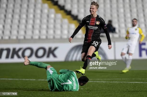 Football Europa League Group Phase Group A 6th Matchday Larnaca Bayer Leverkusen at GSP Stadium Sam Schreck from Leverkusen jumps over goalkeeper...