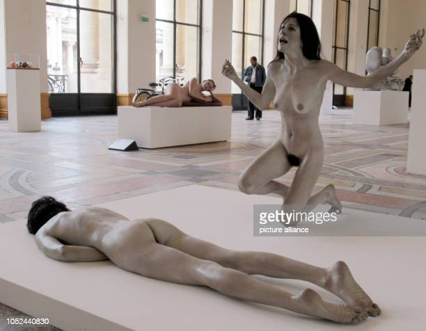 The sculptures 'Woman' and 'Man' by John Deandrea in the background the sculpture 'Jennifer' by John Deandrea in the Petit Palais are part of the...