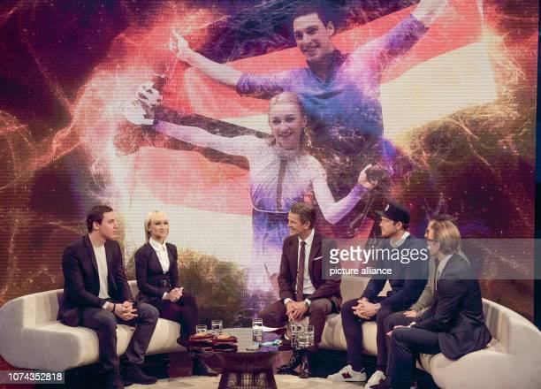 Aljona Savchenko and Bruno Massot figure skater sit on stage together with Markus Lanz presenter Danny von Birken Yannic Seidenberg and Christian...