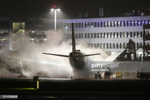 An aircraft is deiced before departure at Hamburg Airport In the Hanseatic city there was the first snowfall this winter in the evening Photo Bodo...