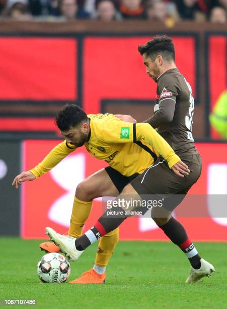 Soccer 2nd Bundesliga 15th matchday FC St Pauli Dynamo Dresden in the Millerntor Stadium Dresden's Aias Aosman and Hamburg's Ersin Zehir fight for...