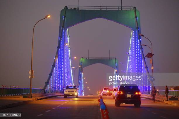 December 2018, Iraq, Baghdad: Cars traversing the 14th of July Bridge which links the Iraqi capital Baghdad's southern Karrada district to the...