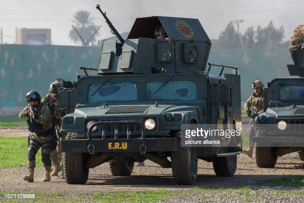 Iraqi military soldiers take part in a ceremonial military drill marking the first anniversary of Iraq's victory over the Islamic State group at a...