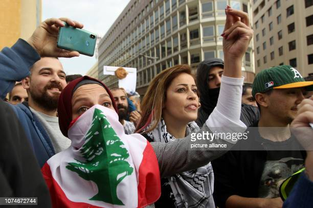 December 2018, Lebanon, Beirut: Lebanese people take part in a protest against the months-long failure of rival political factions to agree on...