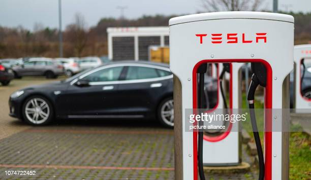 22 December 2018 Lower Saxony Bispingen Tesla charging stations are located on a parking lot at the Snow Dome in Bispingen Photo Philipp Schulze/dpa