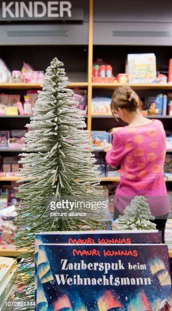 A bookseller sorts the display in a branch of the bookseller Hugendubel Books still belong to the most popular Christmas presents of the Germans...