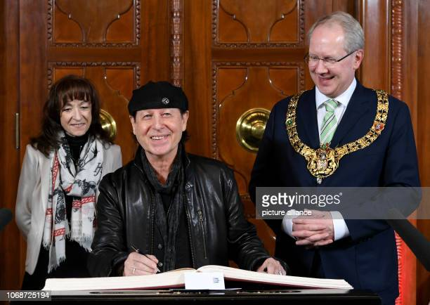In the presence of his wife Gabi Meine and Hanover's Lord Mayor Stefan Schostok rock singer Klaus Meine enters himself in the Golden Book of the City...