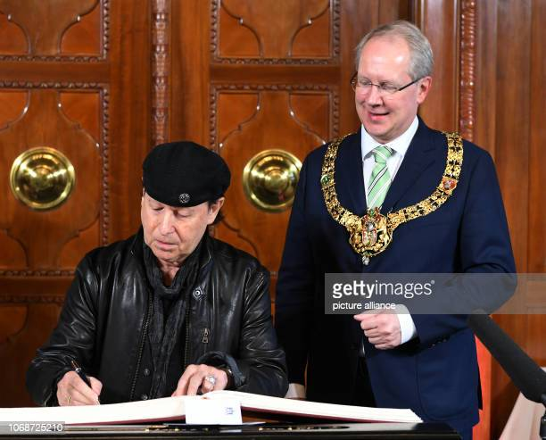 Rock singer Klaus Meine enters himself in the Golden Book of the City of Hannover in the presence of Hannover's Lord Mayor Stefan Schostok In the...