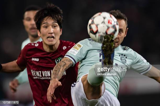 Soccer Bundesliga Hannover 96 Bayern Munich 15th matchday in the HDIArena Munich's Rafinha plays against Hanover's Takuma Asano Photo Swen...