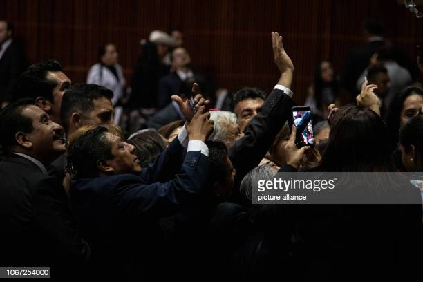 Andres Manuel Lopez Obrador waves surrounded by supporters after he has been sworn in as the new Mexican president Photo Gerardo Vieyra/dpa