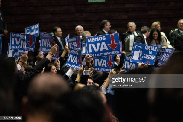 Lowering the tax at the border is what a group of parliamentarians are holding up on the posters of leftwing politician Lopez Obrador during his...