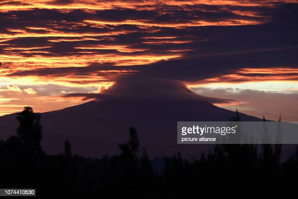 The sun rises behind the volcano Popocatepetl Popocatepetl has been showing increased activity for several weeks Photo Gerardo Vieyra/dpa