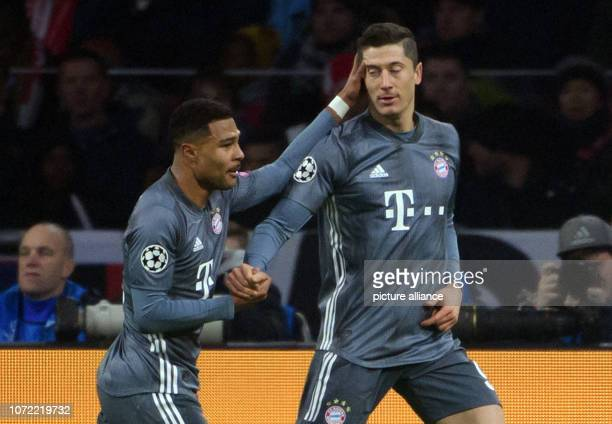 Soccer Champions League Ajax Amsterdam Bayern Munich Group stage Group E 6 th matchday in the in the Johann Cruyff ArenA Serge Gnabry cheers with...